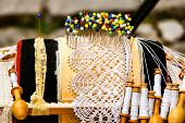 stock photo of thread-making  - Beautiful laces manufactured handcrafted with lace pillow and its accessories - JPG