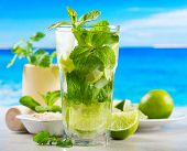 picture of mojito  - mojito cocktail with fresh fruits on beach - JPG