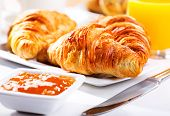 stock photo of croissant  - breakfast with fresh plate of croissants and jam - JPG