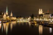 stock photo of zurich  - Zurich on banks of Limmat river at winter evening - JPG