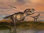 stock photo of tyrannosaurus  - Two tyrannosaurus rex dinosaurs walking with pteranodon birds flying upon in desertic landscape by cloudy sunset - JPG