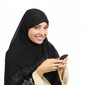 picture of arabic woman  - Arab saudi emirates smiling woman using a smart phone isolated on a white background - JPG