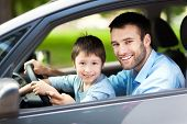 image of car-window  - Father and son sitting in a car - JPG