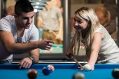 stock photo of pool ball  - Young Caucasian Woman Receiving Advice On Shooting Pool Ball While Playing Billiards - JPG