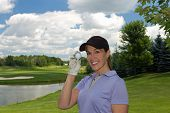 stock photo of ladies golf  - Female golfer holding a golf ball in her hand - JPG