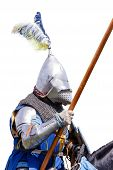 pic of jousting  - Armoured knight on warhorse with shield and lance isolated on white - JPG