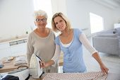 stock photo of housekeeping  - Portrait of senior woman with housekeeper - JPG
