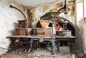 stock photo of wine-press  - Vintage old abandoned winery old equipment and grape presses - JPG