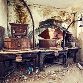 pic of wine-press  - Vintage old abandoned winery old equipment and grape presses - JPG