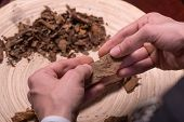 image of tobacco leaf  - Selective focus on the process of making cigars from dried up leaves of tobacco plant - JPG