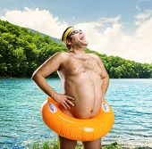 image of nake  - Strange naked man on the lake - JPG