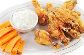 foto of dipping  - A dish of chicken hot wings and carrots with dipping sauce - JPG