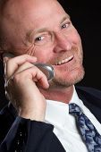 picture of portrait middle-aged man  - Smiling business man talking on cell phone - JPG