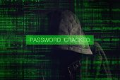 image of incognito  - Password Cracked by Faceless hooded anonymous computer hacker with programming code from monitor - JPG