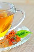 pic of marigold  - marigold herbal tea in glass cup and marigold flower - JPG