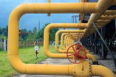 stock photo of pipe-welding  - Pipes with valves and manometers on cooling gas compressor station installation - JPG