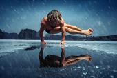 stock photo of frozen  - Man doing yoga exercise  - JPG