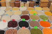stock photo of soya beans  - Beans and grains groceries in bulk bags at market - JPG