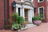 pic of pilaster  - Historic mansion entrance in Jacobean architectural style decorated with plants in Duluth Minnesota - JPG