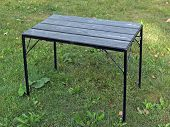 Metal outdoor table for picnic poster