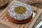 picture of mixed nut  - Nuts mix cake and ingredients on rustic ambient - JPG