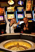 foto of roulette table  - couple playing roulette in casino and winning - JPG
