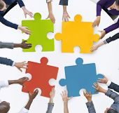 image of puzzle  - Teamwork Business Team Meeting Unity Jigsaw Puzzle Concept - JPG