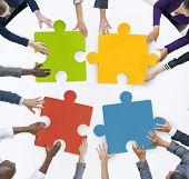 stock photo of jigsaw  - Teamwork Business Team Meeting Unity Jigsaw Puzzle Concept - JPG