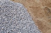 stock photo of sand gravel  - piles gravel and sand for construction industry - JPG