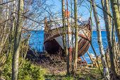 stock photo of wrecking  - The front end of an old passanger ship now wrecked and pulled on shore - JPG