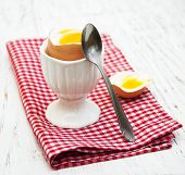 pic of boil  - boiled egg for breakfast on a old wooden table - JPG