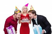 foto of birthday hat  - Funny picture of young people standing isolated on white background - JPG