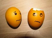 pic of pity  - broken egg and another one with faces - JPG