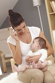 picture of lap  - Young mother talking on mobilephone - JPG