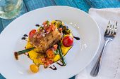 picture of pork belly  - Crispy pork belly on kabocha squash puree with tomatoes and asparagus topped with pico de gallo - JPG