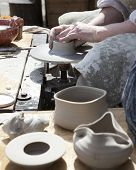 foto of molding clay  - The potter during a jug molding .Close up ** Note: Shallow depth of field - JPG