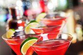 pic of cosmopolitan  - Four Cosmopolitan cocktails shot on a bar counter - JPG