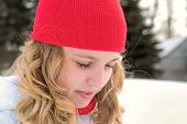 picture of knitted cap  - Young teenage Caucasian girl with red knit cap in winter - JPG