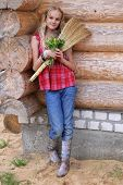 picture of country girl  - Country smiling girl on the background of the log house - JPG