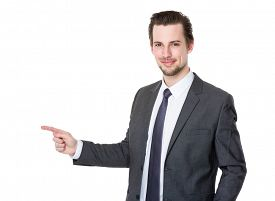 image of politician  - Handsome businessman or attorney or politician pointing aside - JPG