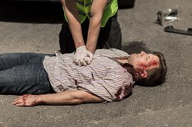 picture of accident victim  - First aid for bloody car accident casualty - JPG