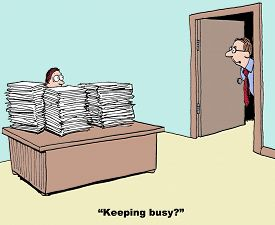 foto of piles  - Business cartoon showing businessman whose desk is stacked with piles and piles of paper - JPG