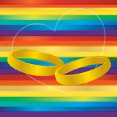 stock photo of gay symbol  - gay marriage rainbow symbol with gold rings - JPG