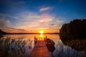 Sunset Over The Fishing Pier At The Lake In Finland poster