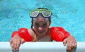 stock photo of floaties  - Child Swimming With Goggles and Floaties in a Pool - JPG