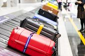 Baggage Luggage On Conveyor Carousel Belt At Airport Arrival poster