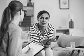 Confused Young Woman With Social Problem During Psychologist Meeting , Black And White Photo poster