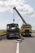Burned Coach Bus At Highway Recovery Assistance poster