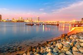 Twilight At San Diego Downtown And Coronado Bridge From Beach Shoreline Of Coronado Island, Californ poster