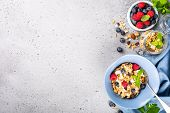 Healthy Food Background With Homemade Oatmeal Granola Or Muesli With Yogurt And Fresh Berries For He poster